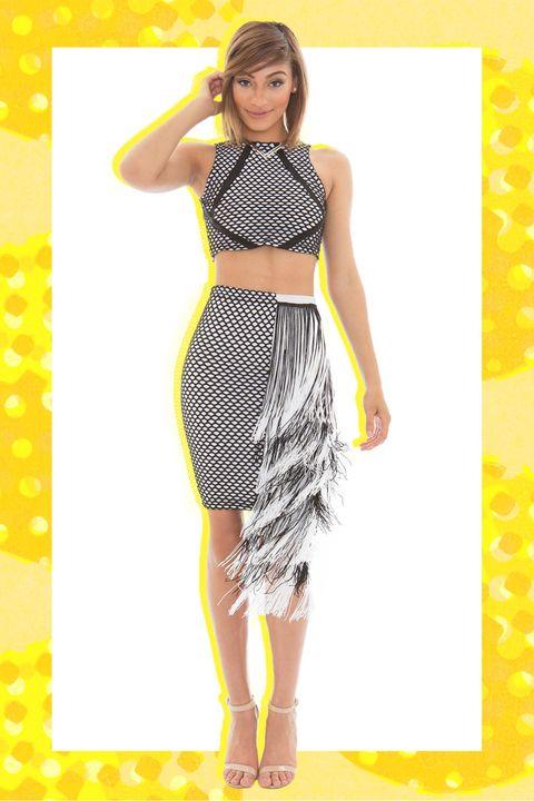 Leg, Yellow, Shoulder, Dress, Human leg, Joint, Pattern, Style, One-piece garment, Waist,