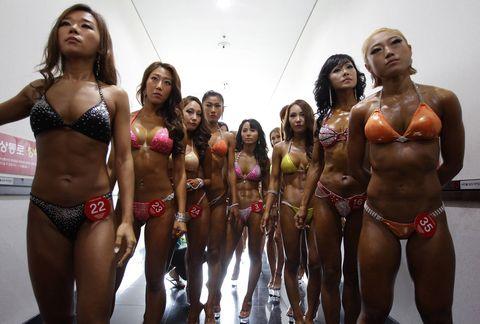 People, Brassiere, Chest, Abdomen, Trunk, Bikini, Swimsuit top, Thigh, Undergarment, Swimsuit bottom,