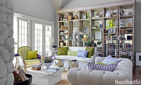 "<p>In a <a href=""http://www.housebeautiful.com/decorating/house-pictures/colorful-cottage-decorating-ideas-0613"" target=""_blank"">California cottage</a> designed by Stephen Shubel, mirrors installed along the back of the built-in shelving give the wall depth.</p>"