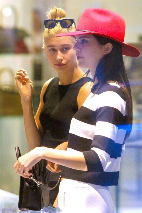Sleeve, Human body, Hat, Hand, Headgear, Costume accessory, Fashion, Youth, Sun hat, Goggles,