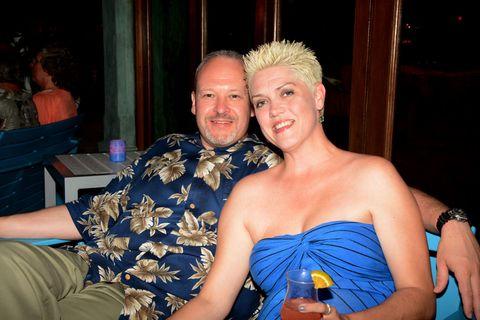 Fun, Strapless dress, Drink, Orange, Wrist, Dress, Cobalt blue, Alcoholic beverage, Distilled beverage, Cocktail dress,