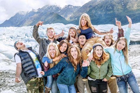 Face, Mountainous landforms, Smile, Winter, People, Social group, Denim, Tourism, Mountain range, Jeans,