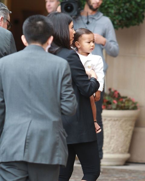 """North West already has a good """"paparazzi face"""" down."""