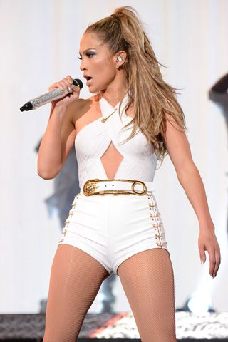 J.Lo wears a white leotard with cutouts and a very prominent safety pin at her first ever hometown concert to launch State Farm Neighborhood Sessions on June 4, 2014 in Bronx, New York.