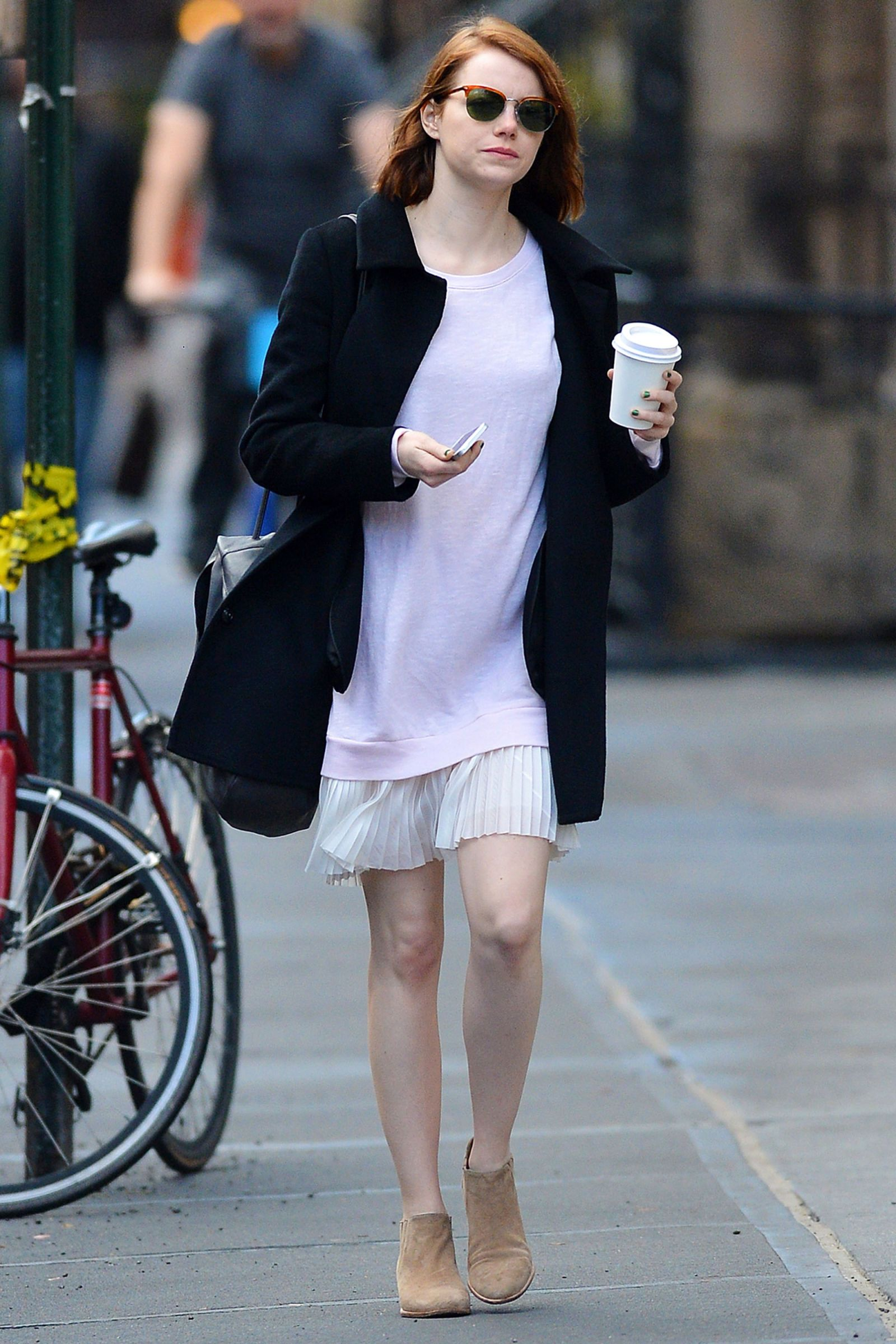 Emma Stone drinks coffee in New York City's West Village neighborhood on on Nov. 24, 2014.