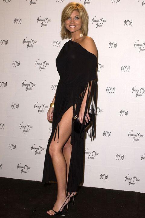 f857d57aa39 Tiffani Amber Thiessen Critiques Her '90s Looks