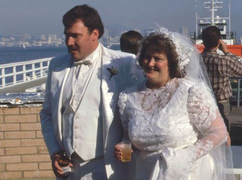 Hair, Head, Dress shirt, Happy, Coat, Formal wear, Dress, Drink, Ceremony, Bridal clothing,