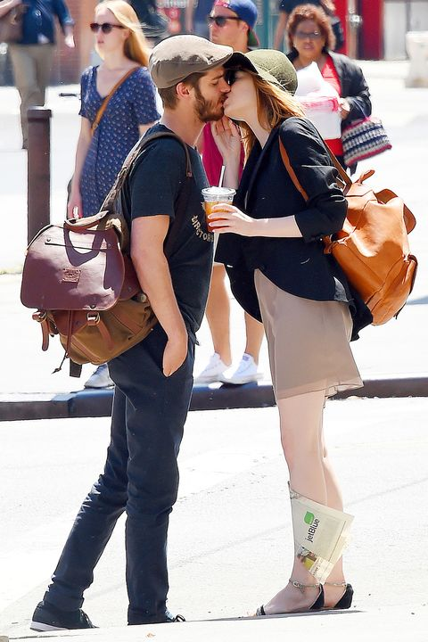 Emma Stone and Andrew Garfield give each other a kiss goodbye before leaving Cafe Cluny in New York City on June 16, 2014.