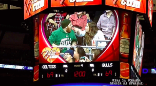 Kiss Cam Captures Couple's Hilarious Cell Phone Fight