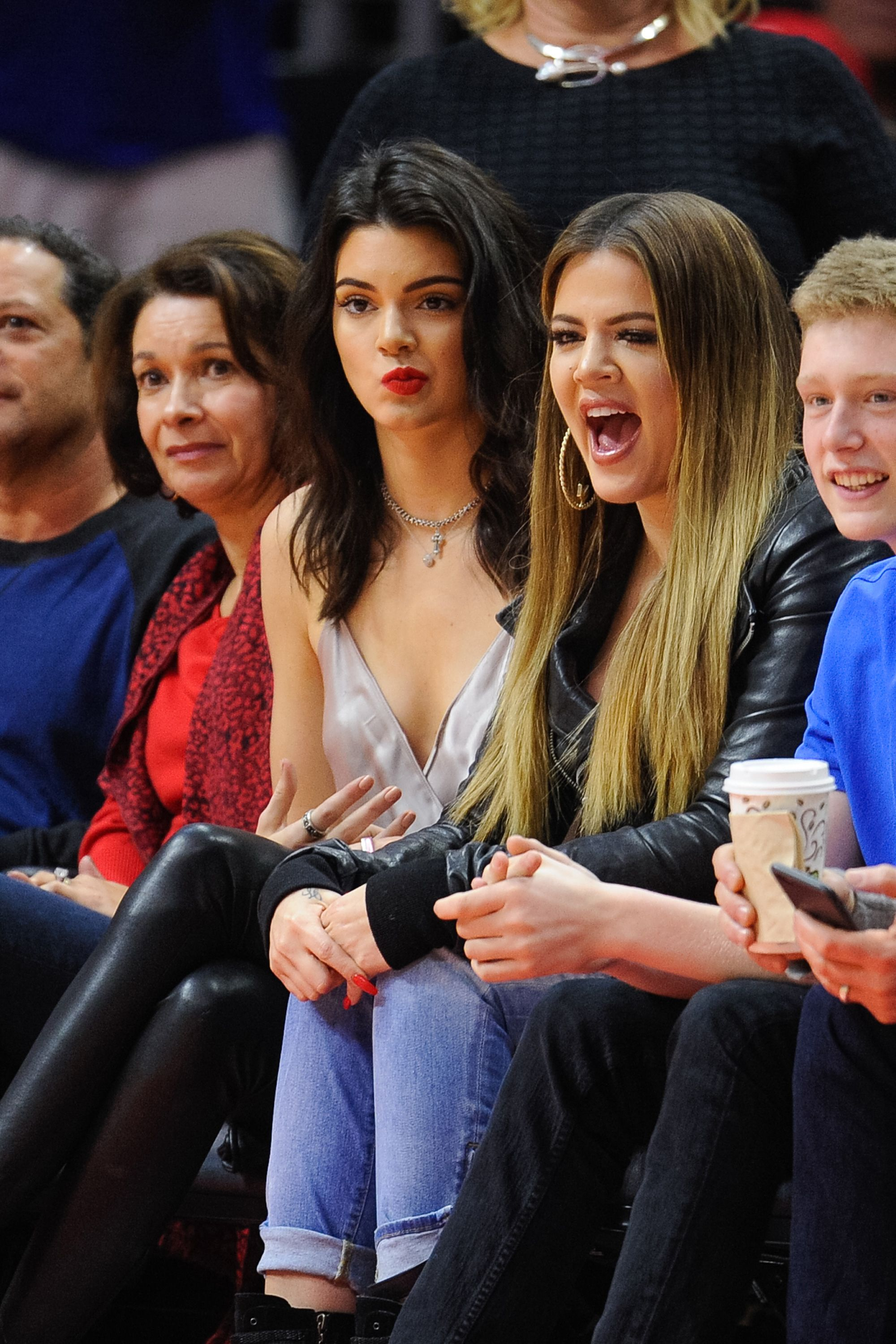Kendall Jenner (L) and Khloe Kardashian attend a basketball game between Dallas Mavericks and the Los Angeles Clippers at Staples Center on January 10, 2015 in Los Angeles, California.