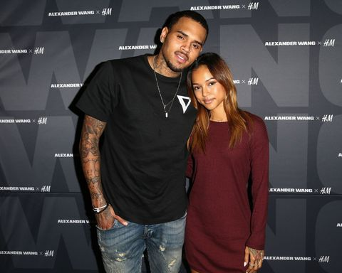 Caption:WEST HOLLYWOOD, CA - NOVEMBER 05: Recording artist Chris Brown (L) and model Karrueche Tran attend the Alexander Wang x H&M Pre-Shop Party at H&M on November 5, 2014 in West Hollywood, California. (Photo by Imeh Akpanudosen/Getty Images for H&M)