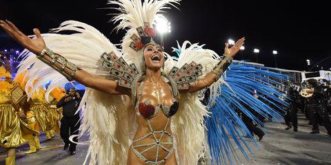 Event, Entertainment, Performing arts, Samba, Headgear, Feather, Carnival, Muscle, Dancer, Abdomen,