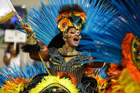 Event, Performing arts, Entertainment, Tradition, Headgear, Fashion accessory, Art, Carnival, Feather, Dance,