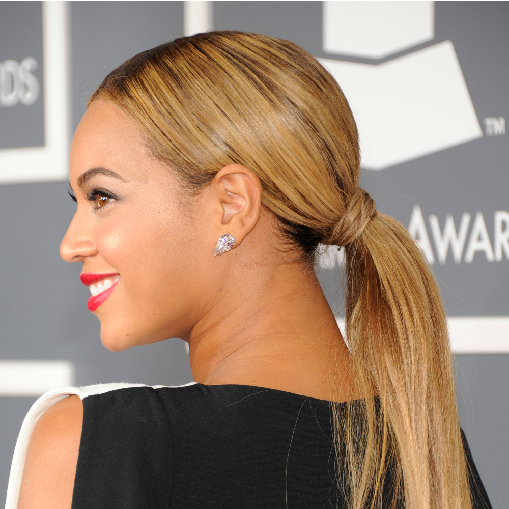 Want to try&nbsp&#x3B;Beyoncé's perfectly glam pony?&nbsp&#x3B;Use a&nbsp&#x3B;boar bristle brush to direct&nbsp&#x3B;your&nbsp&#x3B;strands back, then&nbsp&#x3B;smooth a quarter-size amount of gel&nbsp&#x3B;from your hairline to the base of your pony&nbsp&#x3B;to calm any flyways and add&nbsp&#x3B;shine. Then, put your hair into a low pony and wrap a sliver of hair from under your pony around the elastic band to make it flawless and&nbsp&#x3B;*~FaNcY~*.