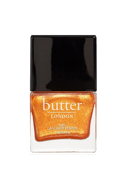 "Sunny getaways call for a color that's just <em>fun</em>. Your move, nudes.   <em>Butter Nail Lacquer in ""Chuffed,"" $15; <a href=""http://www.butterlondon.com/Lacquers/Orange-Nail-Lacquers/Chuffed-Nail-Lacquer.html"" target=""_blank"">butterlondon.com</a></em>"