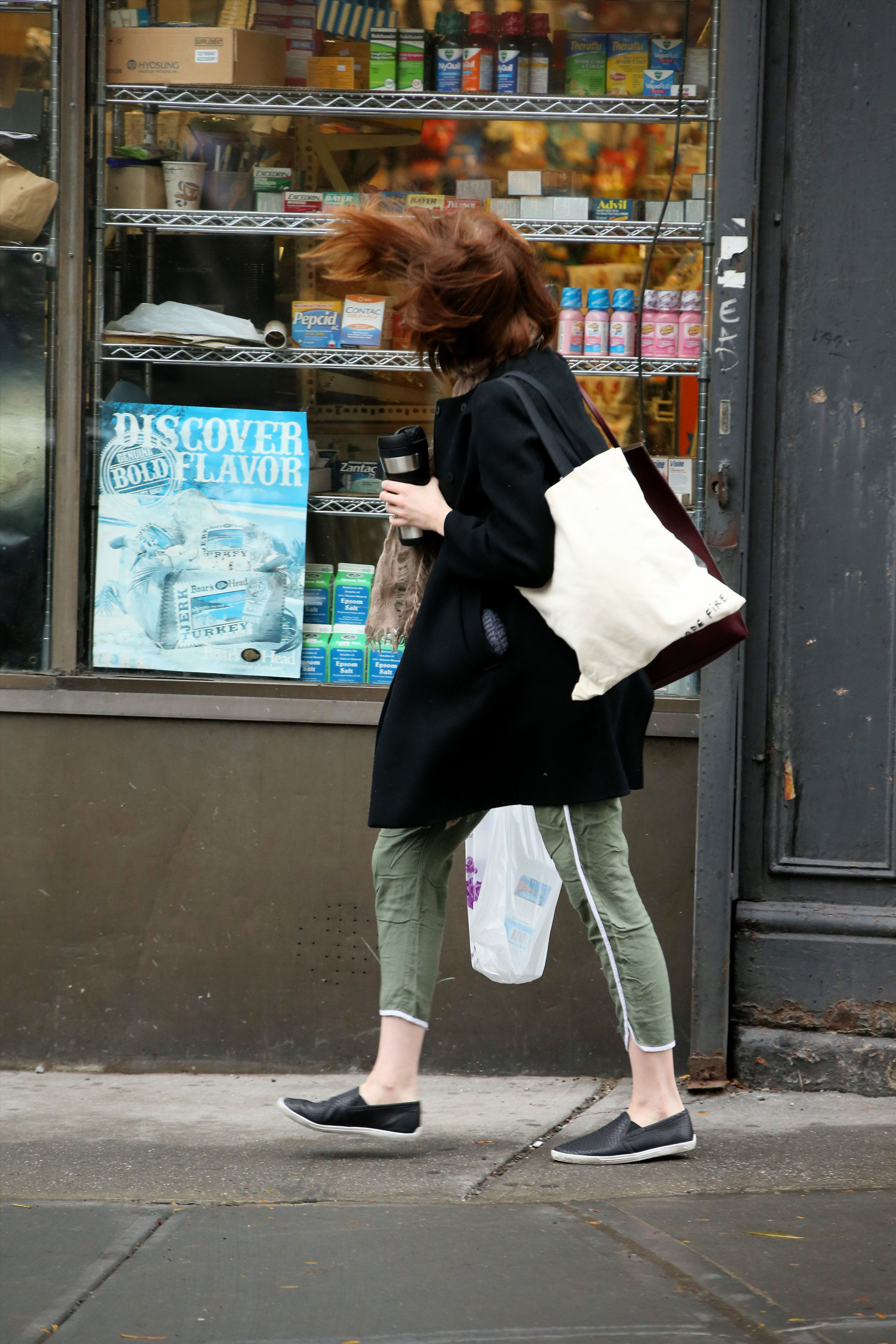 Actress Emma Stone gets into a hair battle with the wind as she grabs a cup of coffee before her matinee performance of 'Cabaret' on October 22, 2014 in West Village, New York City.&lt&#x3B;P&gt&#x3B;Pictured: Emma Stone&lt&#x3B;P&gt&#x3B;&lt&#x3B;B&gt&#x3B;Ref: SPL872259  221014  &lt&#x3B;/B&gt&#x3B;&lt&#x3B;BR/&gt&#x3B;Picture by: Christopher Peterson/Splash News&lt&#x3B;BR/&gt&#x3B;&lt&#x3B;/P&gt&#x3B;&lt&#x3B;P&gt&#x3B;&lt&#x3B;B&gt&#x3B;Splash News and Pictures&lt&#x3B;/B&gt&#x3B;&lt&#x3B;BR/&gt&#x3B;Los Angeles:310-821-2666&lt&#x3B;BR/&gt&#x3B;New York:212-619-2666&lt&#x3B;BR/&gt&#x3B;London:870-934-2666&lt&#x3B;BR/&gt&#x3B;photodesk@splashnews.com&lt&#x3B;BR/&gt&#x3B;&lt&#x3B;/P&gt&#x3B;