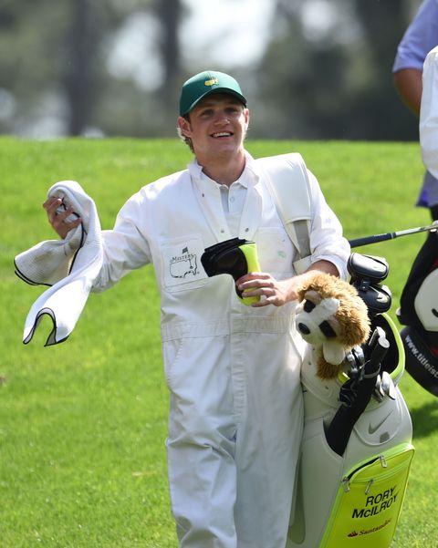 Cap, Baseball cap, Glove, Bird, Golf equipment, Toy, Golf club, Iron, Cricket cap,