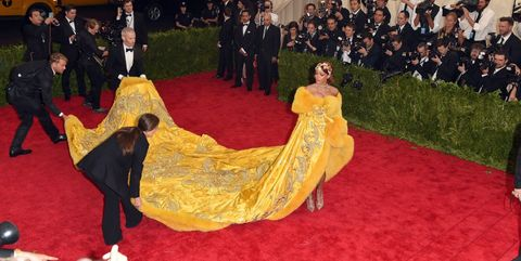 Human, Yellow, Event, Flooring, Formal wear, Carpet, Gown, Tradition, Costume design, Costume,
