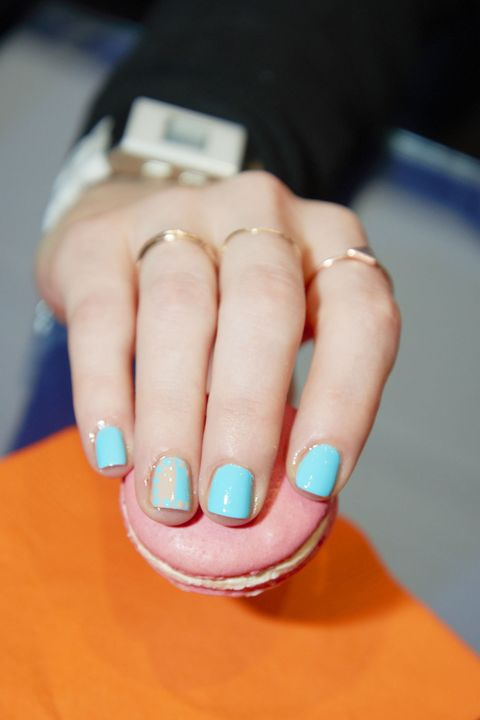 Neon nails are hot for summer–as long as you keep them grounded. Pair Complete Salon Manicure Beachside Astrologer Lady Libra-ty polish with a nude Cup O' Capricorn accent, and you get celestial perfection.