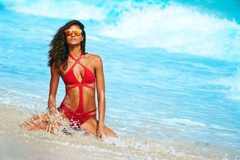 """<strong>What's the best workout for a killer bikini body?  </strong>""""I love Muay Thai. I never get bored with it—you're constantly moving and punching and kicking. It's an aggression reliever too.""""  <em><strong>Swimsuit</strong>, Argent Provocateur; <strong>Sunglasses</strong>, Illesteva. </em>"""