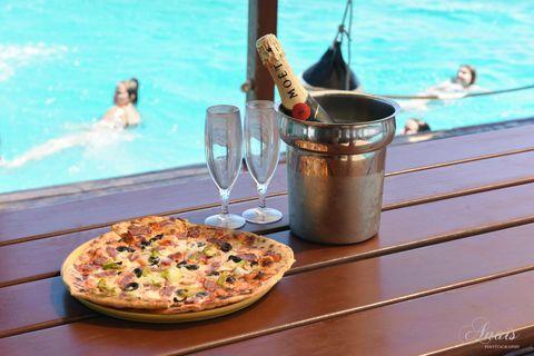 Fluid, Food, Liquid, Water, Swimming pool, Pizza, Cuisine, Dish, Baked goods, Tableware,