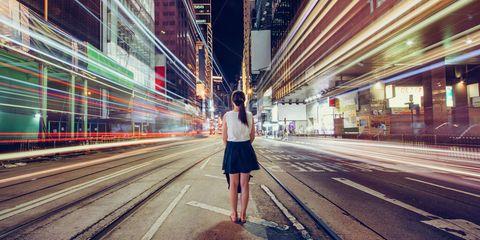 Brown, Urban area, Human leg, Standing, Metropolitan area, Street fashion, Pedestrian, Metropolis, Tints and shades, Electricity,