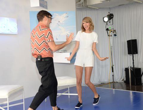 Leg, Shoulder, Shirt, Standing, T-shirt, Dress, Waist, Public address system, Holding hands, Gesture,