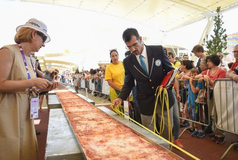 Here's a Picture of the World's Longest Pizza, Try Not to Cry Too Hard