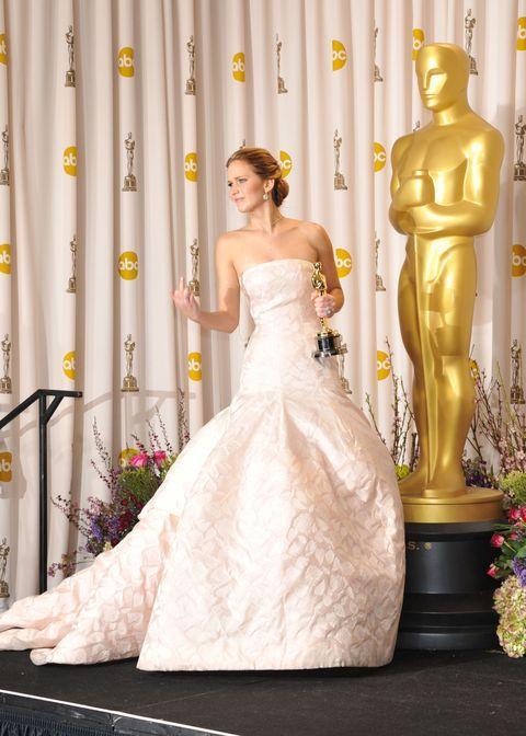Human, Yellow, Shoulder, Textile, Bridal clothing, Dress, Gown, Wedding dress, Bride, Petal,