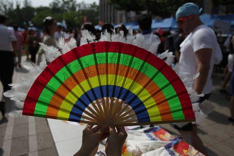 People, Headgear, Cap, Fashion, Crowd, Baseball cap, Festival, Tradition,