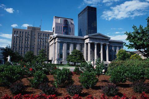 Daytime, Cloud, Shrub, Building, Metropolitan area, Commercial building, Tower block, Real estate, Urban area, Landmark,