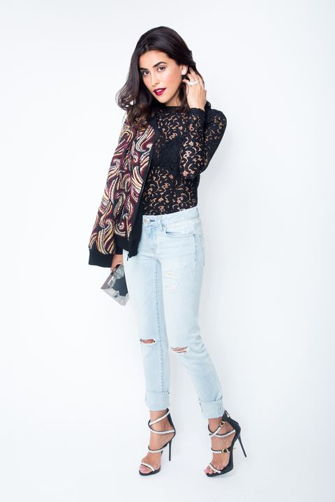 "<p>""Just because it's nighttime doesn't mean you have to wear dark denim!"" Sazan says. Taking a cue from Rihanna, she sports a light wash. Then she dresses it up with a lace bodysuit (you've got to show <em>some</em> skin) and beaded jacket. ""It's '90s meets glam meets comfort,"" she says. </p><p><em>AEO Denim X Skinny Jean in Glacier Crush, <a href=""https://ad.doubleclick.net/ddm/clk/293986021;120297921;i"">AMERICAN EAGLE OUTFITTERS</a>, $49.95; Felisa Embellished Zippered Jacket, <a href=""http://aliceandolivia.com"">ALICE + OLIVIA BY STACEY BENDET</a>, $998; Kiley Bodysuit, <a href=""http://www.mishacollection.com.au/e-store/kiley-bodysuit.html"">MISHA COLLECTION</a>, $132.86; Design Crystal Sandal, <a href=""http://giuseppezanottidesign.com"">GIUSEPPE ZANOTTI</a>, $1495; Stingray Clutch, EMM KUO </em><em>(Available at Annelore, 212-775-0077)</em><em>, $775; Bamboo Stud Earrings 18K White Gold and Diamond, $3730, and Bamboo 3 Finger Ring 18K White Gold and Diamond, <a href=""http://AS29.com"">AS29</a>, $7360.</em> </p>"