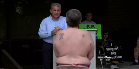 Breast Cancer Survivor Strips to Protest County Official Who Wants to Defund Planned Parenthood