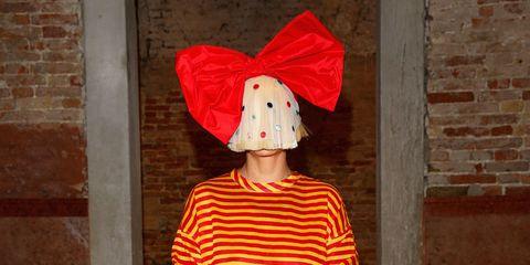 Clothing, Red, Human leg, Dress, Hat, Street fashion, Headgear, One-piece garment, Orange, Pattern,