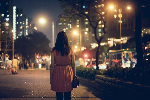 Woman walking alone at night