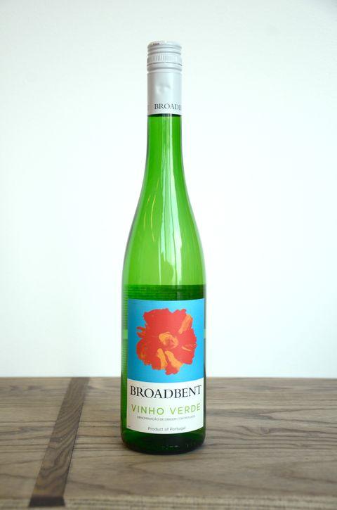 Product, Bottle, Green, Glass bottle, Wood, Ingredient, Alcoholic beverage, Logo, Hardwood, Drink,