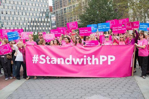 Magenta, Pink, Advertising, Purple, Protest, Violet, Public event, Banner, Poster, Pedestrian,
