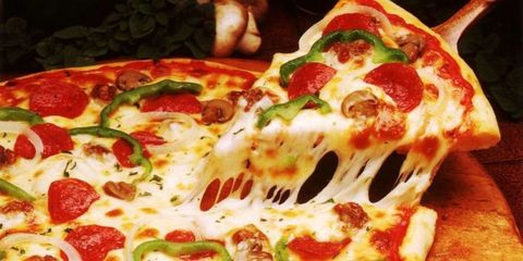 This Chart Shows Exactly How Many Calories You Save by Dabbing Grease Off Pizza