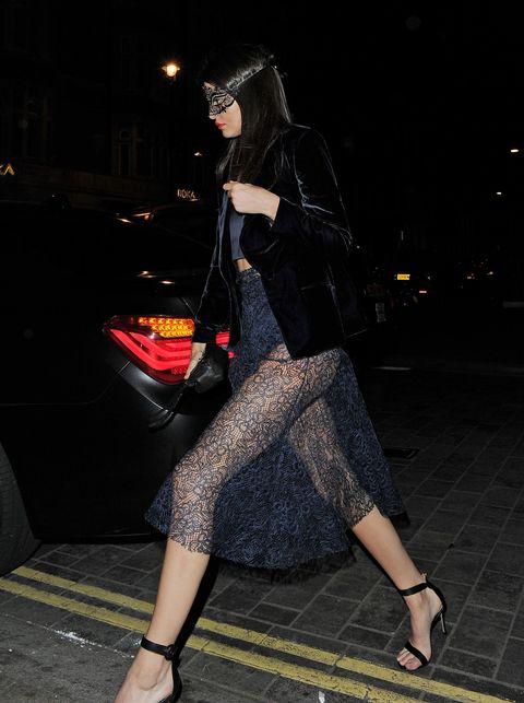 Clothing, Human leg, Outerwear, Bag, Style, Street fashion, Fashion accessory, High heels, Night, Pattern,