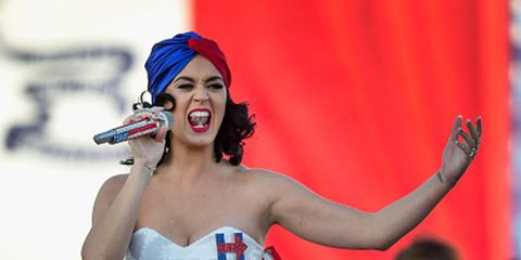Mouth, Lip, Hairstyle, Tooth, Strapless dress, Music artist, Lipstick, Chest, Makeover, Day dress,