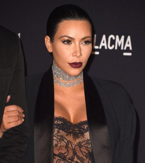 Feast Your Eyes on Kim Kardashian's Sexy See-Through Lace Bodysuit