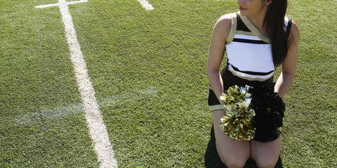 Blonde nice teen girl chearleaders in bra against teen violence