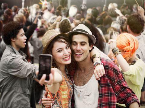 People, Hat, Crowd, Plaid, Tartan, Fashion accessory, Pattern, Headgear, Audience, Jacket,