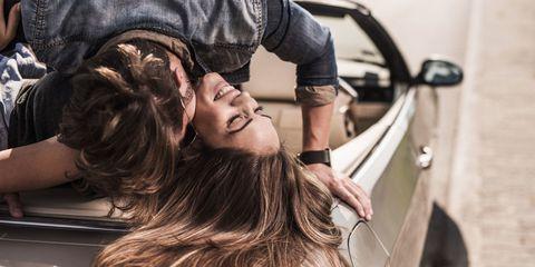Hairstyle, Vehicle door, Long hair, Street fashion, Brown hair, Feathered hair, Automotive window part, Layered hair, Earrings, Step cutting,