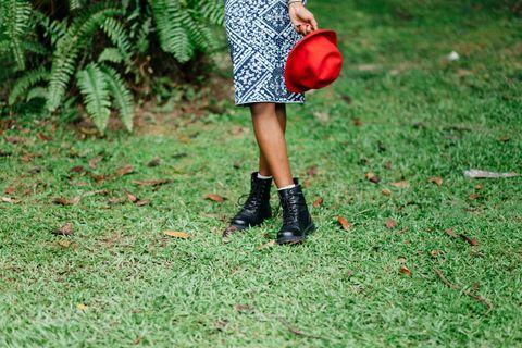 Grass, Human leg, Fashion accessory, Street fashion, Bag, Boot, Calf, Coquelicot, Ankle, High heels,