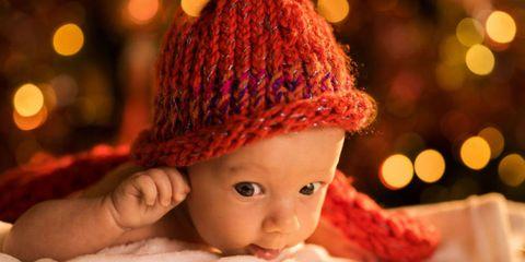 Lip, Cheek, Skin, Textile, Red, Child, Baby & toddler clothing, Headgear, Toddler, Wool,