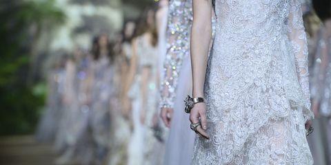 Bridal accessory, Street fashion, Embellishment, Wedding dress, Natural material, Bridal clothing, Silver, Body jewelry, Fashion design, Bride,