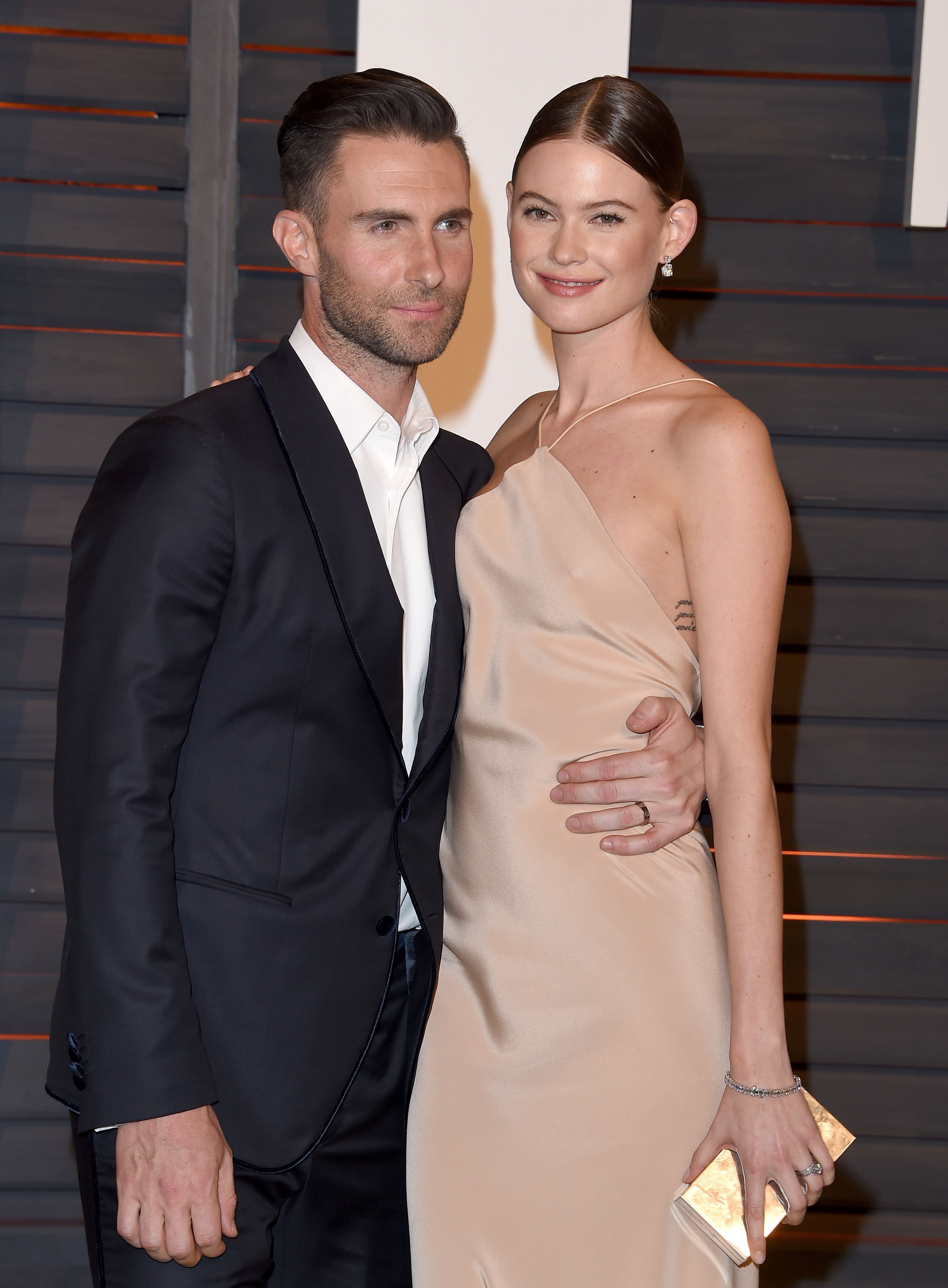 Behati Prinsloo Lifts Her Shirt and Shows the World Her Baby Bump