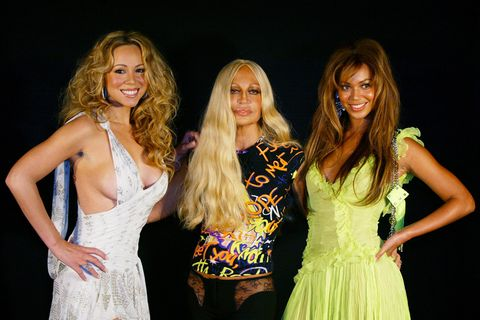 """<p>Mariah smiles confidently with Beyoncé and designer Donatella Versace before Versace's 2004 spring show. """"Your talent is massive as the beauty of your heart,"""" Mariah would <a href=""""https://www.facebook.com/mariahcarey/posts/10152291541083180"""">write of the singer in 2014</a>, to thank her for her birthday greeting.</p>"""