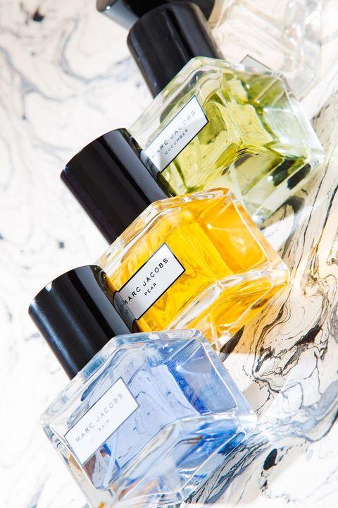 Product, Yellow, Fluid, Bottle, Material property, Label, Bottle cap, Plastic, Perfume, Cosmetics,